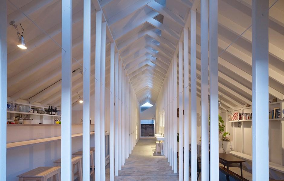 Narrow pillars frame small sleeping lofts