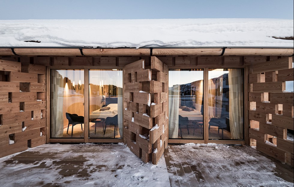 Alternating boards create screens for light and shelter